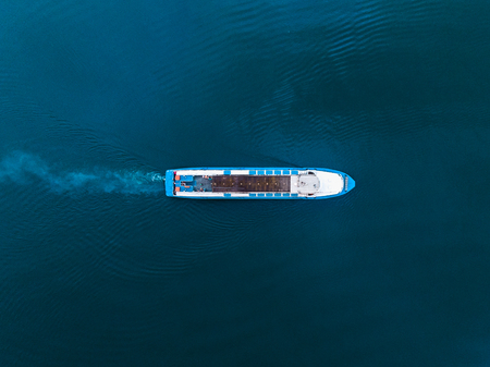 Top view drone of white boat sailing in blue sea Stock Photo - 107413733