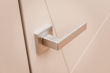 Part metal handle on modern interior door. Stock Photo - 107413737