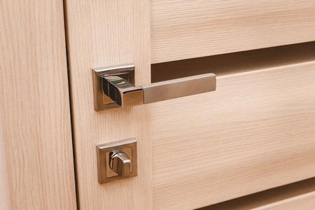 Part metal handle on modern interior door with lock. Stock Photo - 107413742