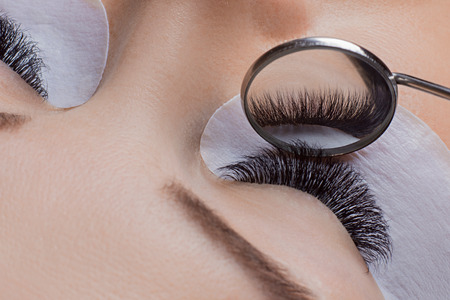 Woman eye with beauty lashes. Eyelash extension procedure. Stock Photo - 107413729