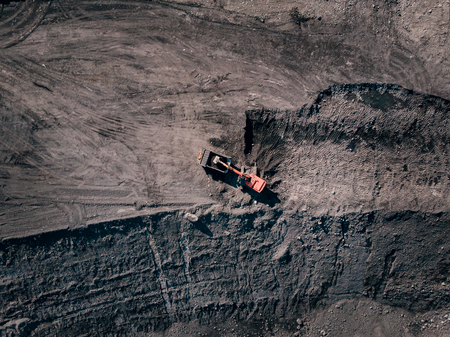 Open pit mine, extractive industry for coal, top view aerial drone. Excavator at work. Stock Photo - 107723601