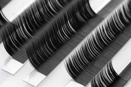 Eyelash extension procedure. Set Lashes close up. Standard-Bild