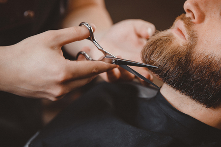 Barber beard styling and cut process. Barbershop for men. Stock Photo