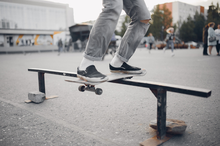 Male skateboarder performs tricks on ramp on skateboard. Concept street sports, bully Stock Photo