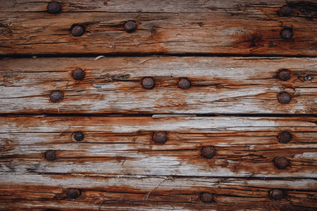Design old dark wood texture background ship with nails