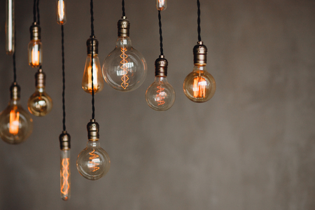 Set edison retro lamp on loft gray concrete background. Concept idea Stock Photo