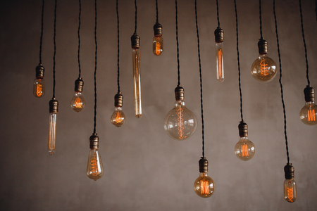 Set edison retro lamp on loft gray concrete background.