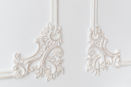 Decoration molding frame item made of white plaster. Relief stucco interior