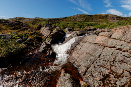Waterfall in the fjord tundra Russia, teriberka Stock Photo