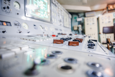 Control panel nuclear power plant close-up industry engineer