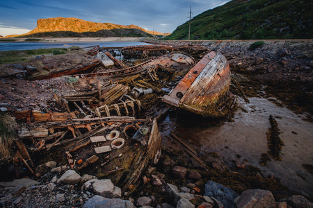 Cemetery of wooden ships pirates and fish-owners, skeletons. Teriberka, Russia.