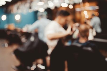 Barbershop. Blurred background hairdresser barber shop men.