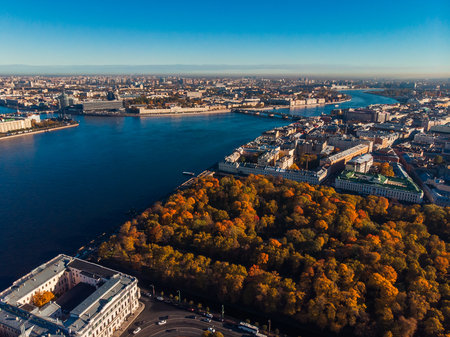 Autumn urban landscape, Park with Golden shade trees, shipping deep blue Neva river, bridges of St. Petersburg, top view