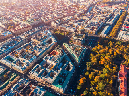 Saint-Petersburg. Autumn urban landscape. Colored roofs of houses and yellow crowns trees, bright Sunny day. Top view aerial drone Stock Photo