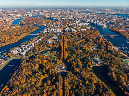 Russia. Saint-Petersburg. Gulf of Finland. Symmetry landscape design. Autumn Central Park culture and rest named after Kirov. High ropes attraction. Ferris wheel. Clear sky. Top view