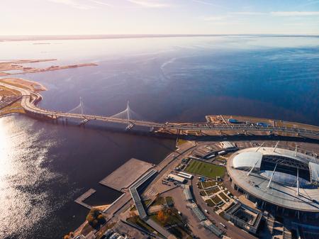 Stadium St. Petersburg. Zenit Arena. Gulf of Finland. Clear autumn day. Blue sky. Helipad. Sun glare Stock Photo