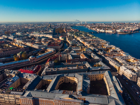 Sun in St. Petersburg. Autumn day. Yards-wells. Neva river. Bridges, rivers and canals. Top view aerial drone