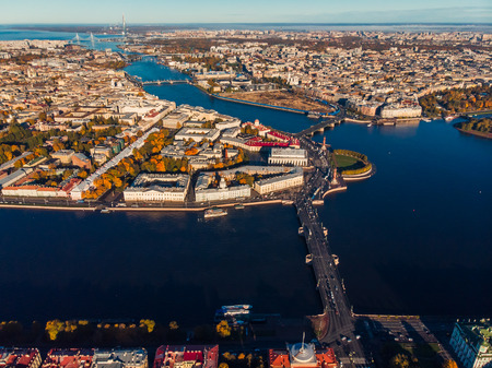 Neva river in early Sunny morning, Palace and other bridges, spit of Vasilievsky island, Rostral columns from birds eye view Stock Photo
