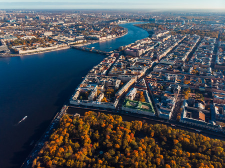 Urban landscape, autumn trees, courtyards, blue waters of Neva river, bridges St. Petersburg. Top view aerial drone Stock Photo