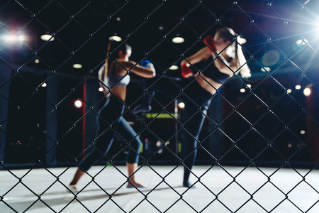 MMA Fight boxing Woman in Octagon Cage ring