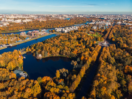 Gulf of Finland. Elagin island. Park culture and rest named after Kirov. Top view autumn trees, urban landscape. Ferris wheel. Warm Sunny day. Saint-Petersburg. Russia