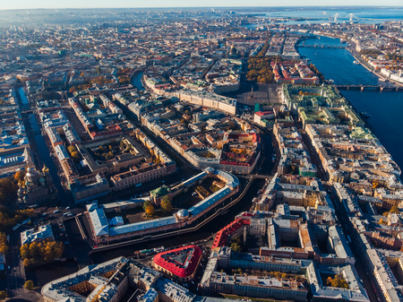 Autumn urban landscape with bird-eye view, crossing streets and canals, Neva river bridges of St. Petersburg. Aerial drone Archivio Fotografico