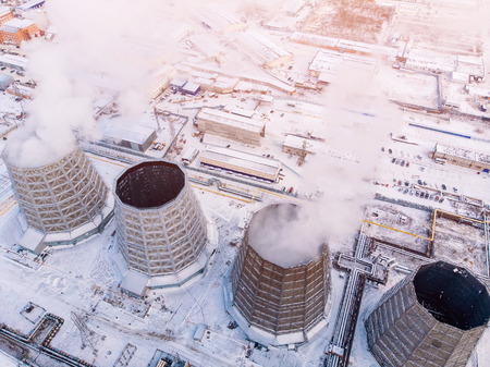 Aerial top view clouds of smoke and steam cooling tower industrial nuclear powerplant. Environmental pollution concept Stock Photo