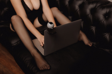 Woman working as Internet webcam model. Shows breasts. Concept virtual sex chat. 写真素材