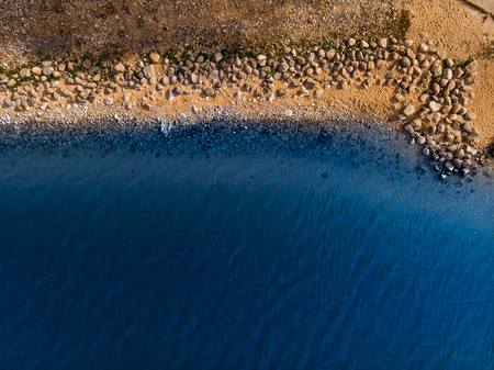 Azure rocky shore, Golden sand, clear water. Top view aerial drone Stock Photo