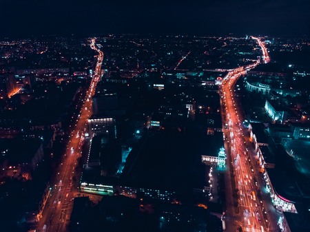 Two parallel roads and city lights. Minsk, Republic of Belarus. Top view aerial drone