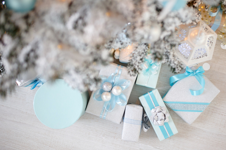 Closeup gifts christmas tree toy light background blue and white color. Stock Photo