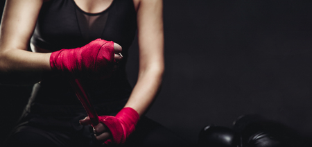 Female boxer wearing bandage gloves for ring. Concept sport. Copy space. Archivio Fotografico