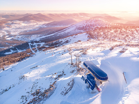 Sheregesh new lift mustag, Kemerovo, Russia, Aerial view drone mountains and forest, winter ski resort Stock Photo