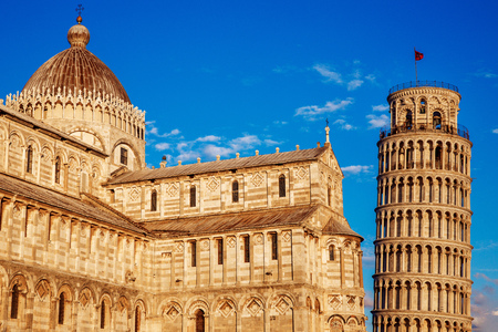 Cathedral and Leaning Tower in sunny day Pisa, Italy. Blue sky.