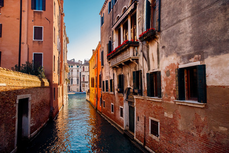 Small canals for boats, old brick houses Venetian style in Venice, Italy. Stock Photo