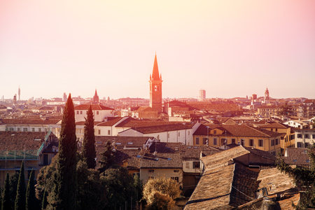 Verona, Italy. Old architecture and river, stone houses on hill. Stock Photo