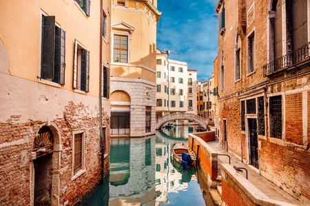 Old houses of Venice, Italy along banks Grand Canal in turquoise water Stock Photo