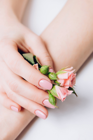 Art photo fashion female hands on white background touch flower, skin care concept, spa rejuvenation, oil from eco nature. Copy space