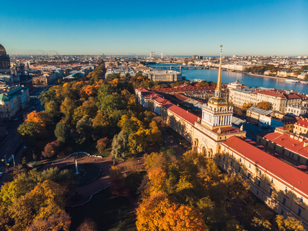 View of red roofs buildings Main Admiralty along river on Sunny autumn day in St. Petersburg