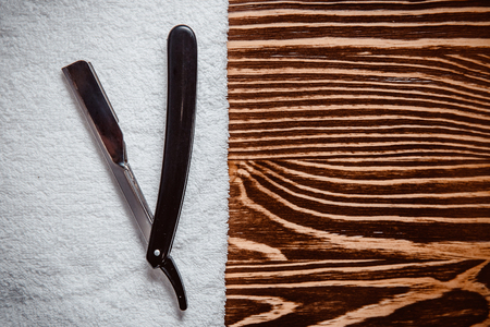 Shaving accessories on luxury wooden top view background. Concept barbershop.
