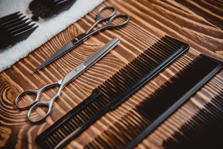 Hairstylist, Shaving and grooming vintage accessories in barber shop. Top view scissors comb Stock fotó