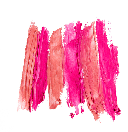 Red and pink lipstick texture white isolated background.