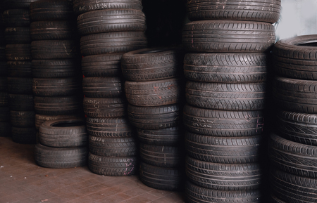 Used tires are in row, concept of recycling rubber wheels.