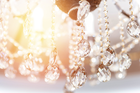 Crystal chandelier shimmers in light of close-up.
