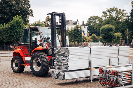 Forklift delivers metal profile from warehouse for construction of building. Stok Fotoğraf