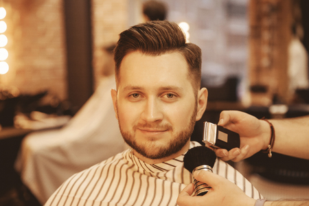 Barbershop, Man with beard in barber shop. Modern hair salon. 写真素材