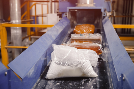 Production line conveyor roller, moved by automatic tape. Stock Photo