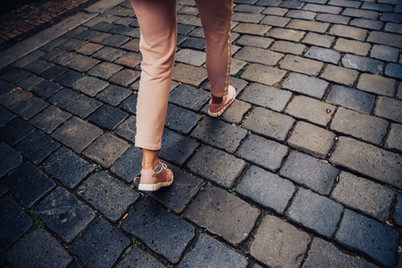 Top view of legs tourists woman in movement walking, concept being late for meeting, in hurry. Stock Photo