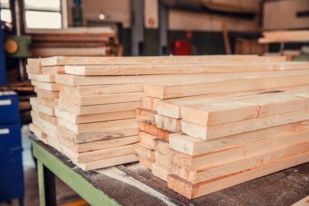 Woodworking, sawmill workshop for production and processing of wood, timber, planks. Stock Photo