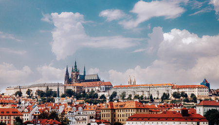 View of colorful Prague europe castle and old town with red tile roofs, Czech Republic. Concept travel.